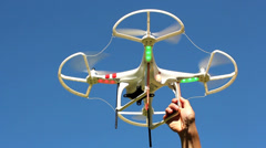 Quadrocopter flying overhead against a blue sky Stock Footage