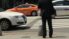 Waiting to cross road Stock Footage