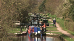 Canal boat and locks Stock Footage