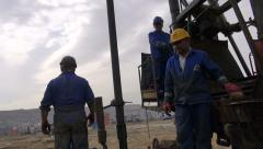 Oil crew, Azerbaijan, industry, maintenance, well, handheld tilt - stock footage