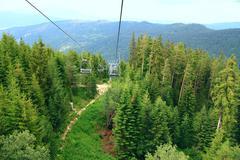 nobody on ski lift above the ski slope - stock photo