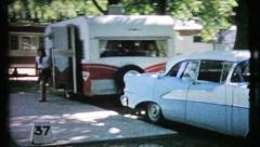 474 - family gets comfortable in trailer at camp ground -vintage film home movie Stock Footage
