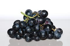 blue grapes from the front - stock photo
