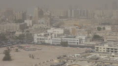 Aerial view of Doha city, Qatar dusty day car traffic street buildings  Stock Footage