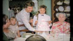 Birthday cake is carried by mom to party, 473 vintage film home movie Stock Footage