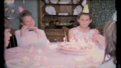 472 - only girls at this birthday party with cupcakes - vintage film home movie Stock Footage