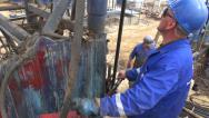 Stock Video Footage of Azeri oil workers in Baku (handheld)