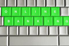 Online banking spelled on a metallic keyboard Stock Photos