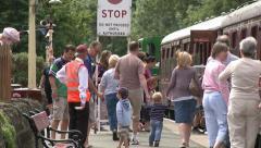 Passengers Boarding Vintage Steam Train Stock Footage