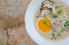 rice gruel with pork and egg mixed - stock photo