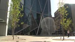 The Bow tilt up across Centre Street, Wonderland art, editorial Stock Footage