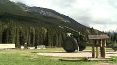 Rogers pass and 105mm gun, transport truck on highway, wide shot - stock footage