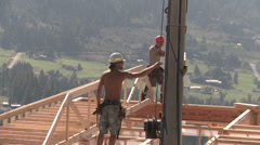 Home construction crane lowering trusses, medium shot Stock Footage