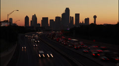 Dallas Skyline silhouete Time-lapse with trafic at sunrise Stock Footage