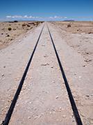railroad track leading nowhere - stock photo