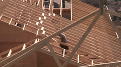 Home construction lift trusses through frame Stock Footage