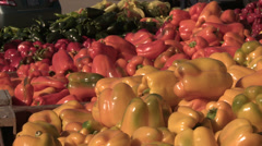At the market, yellow and red peppers, handheld Stock Footage
