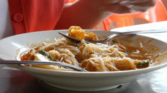 Eating a plate of mee siam. (EATING MEESIAM--1B) Stock Footage