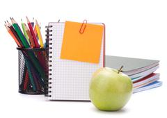 Blank notebook sheet and apple. Stock Photos
