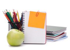 blank notebook sheet and apple. - stock photo