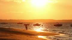 Family boys playing on sunset beach vacation, France Stock Footage