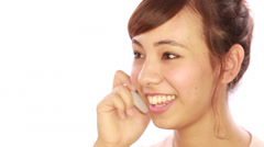 Asian caucasian mixed woman calling talking on cellphone - stock footage