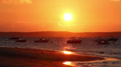 Sunset beach with boats establishing shot background - 1080p Stock Footage