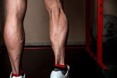 Muscular man calves Stock Photos