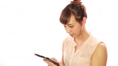 Asian caucasian mixed woman using ipad tablet pc computer Stock Footage