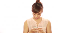 Asian caucasian mixed woman texting message on smart phone cellphone - stock footage