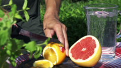 Woman cutting lemon into slices, slow motion shot at 60fps Stock Footage