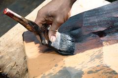 Painting wood slab - stock photo