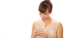 Asian caucasian mixed woman texting message on cellphone Stock Footage