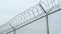 Barbed wire fence. Rack focus. Stock Footage