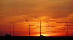 Cars silhouettes on road against sunset - timelapse - stock footage