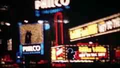 497 - advertisements on New York City neon lights - vintage film home movie Stock Footage