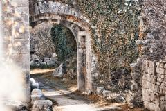 Old castle backyard with stone arches Stock Illustration