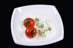 milky soup with tiny red tomatoes - stock illustration