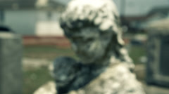 rack focus to cemetary statue - stock footage