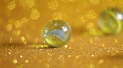 Glittering golden marble balls Stock Footage