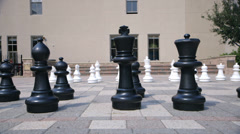 Dolly right large chess pieces Stock Footage