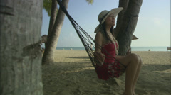 girl on hammock, relaxing at beach - stock footage