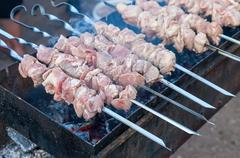 Preparation of meat slices in sauce on fire Stock Photos