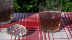 Ice cubes throwing into the glass of whisky, slow motion shot at 240fps Stock Footage