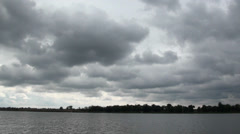Dark clouds over the river Stock Footage