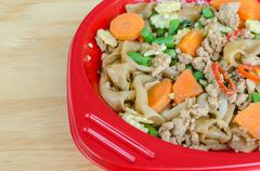 stir-fried flat rice noodles with pork, basil and cow-pea - stock photo