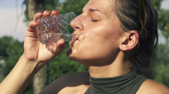 Young woman drinking water, slow motion shot at 480fps Stock Footage