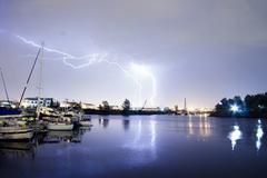 Thunderstorm lightning over thea foss waterway boats tacoma washington Stock Photos