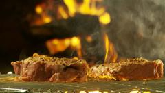 Dolley shot of sirloin steaks on barbecue grid Stock Footage