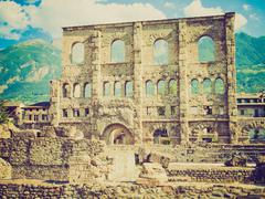 Retro look roman theatre aosta Stock Photos